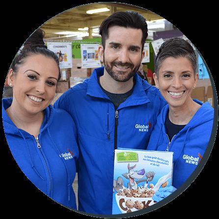 Three volunteers in blue company jackets